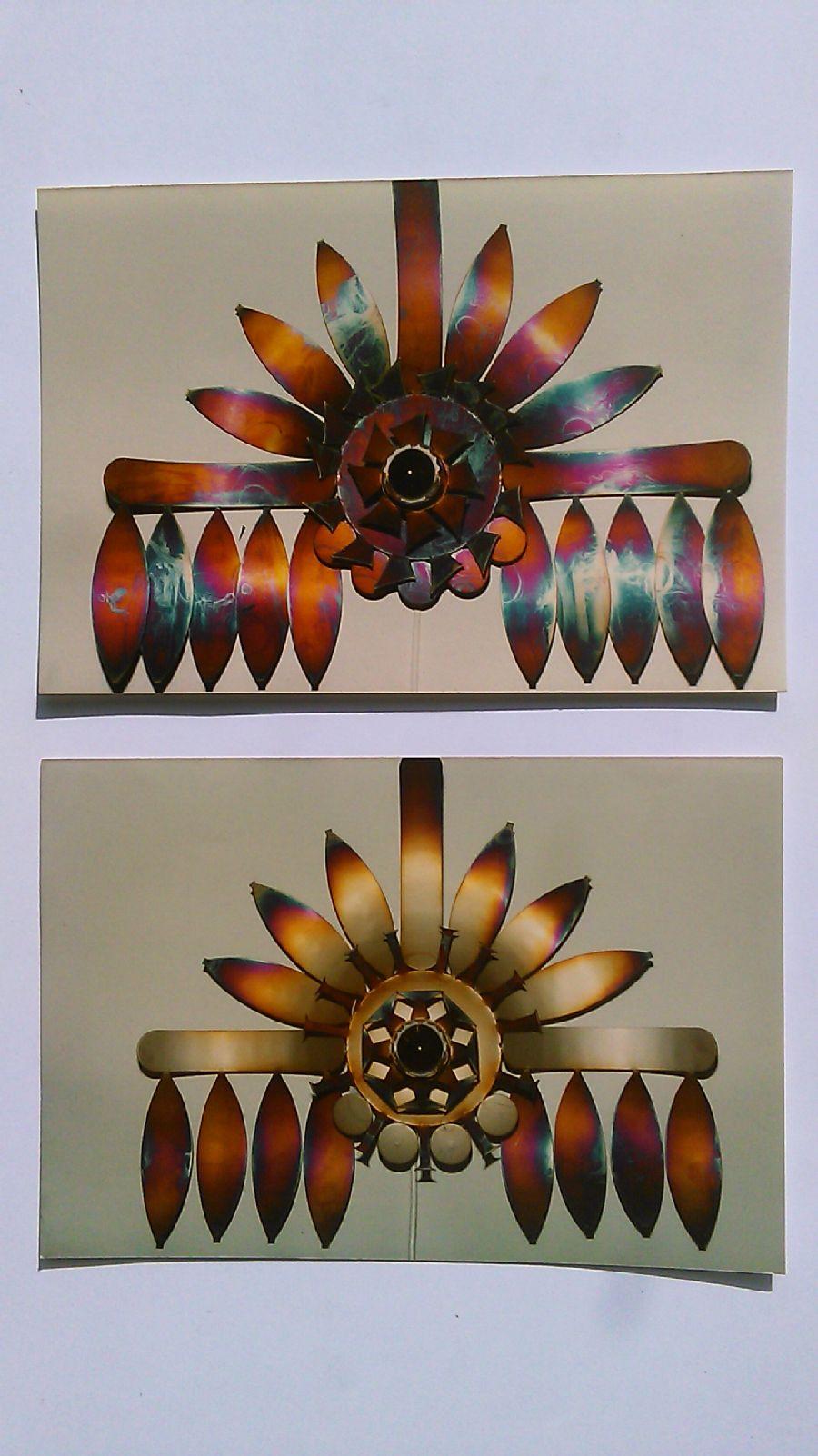 Billedet Blomster i rustfrit stål som er brændt.