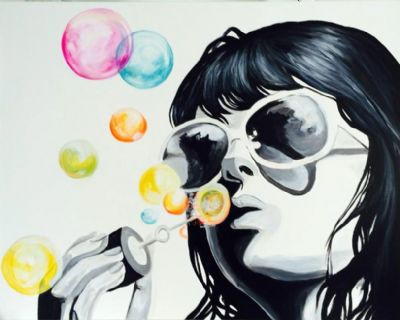 Blowing her dreams as bubbles
